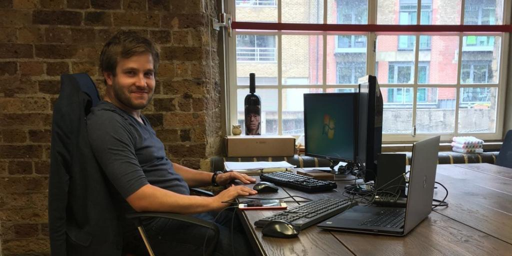 Sasha sitting at his desk in the Strategy Desk office in London