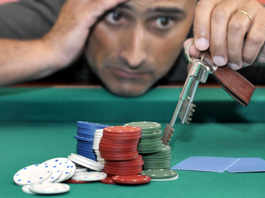 A gambler risks losing their house in a game of poker - how gambling can affect your credit score
