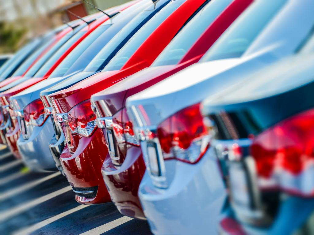 A row of brand new cars for sale in a dealership where Personal Contract Hire deals are sold.