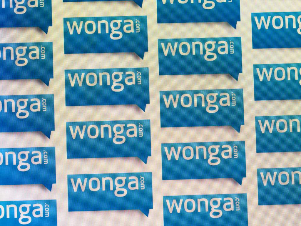Wonga logos on a screen - Wonga was the best known payday loan company in the UK until its collapse in 2018.